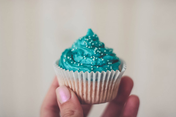 Cupcake With Teal Icing and Sprinkles