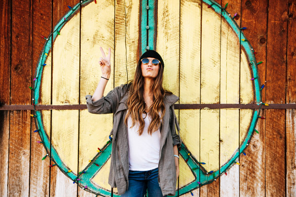hippie woman peace sign wood sunglasses
